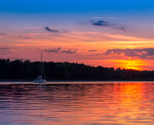 Żeglowanie, Yachting, sail, sailing, water, orange sunset over water, sunrise, sky and clouds, nature