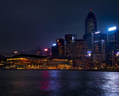 Hong Kong city by night skyscrapers, water reflection, Artur Rydzewski photography