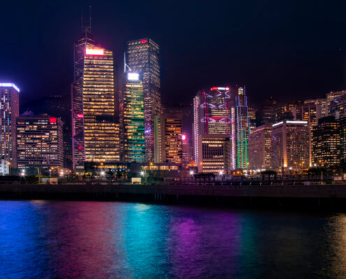 Hong Kong city by night skyscrapers, colorful water reflection, colorful, Artur Rydzewski photography