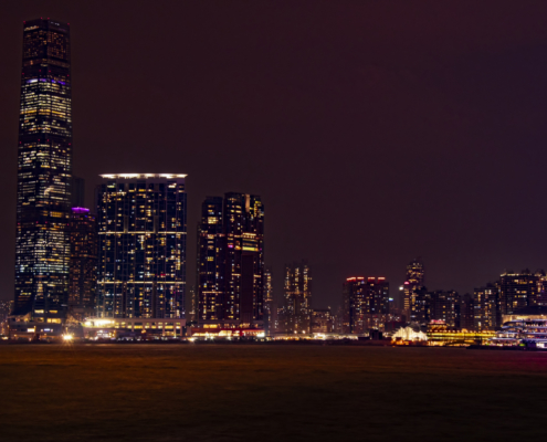 Hong Kong city by night skyscrapers, water reflection, Artur Rydzewski photography