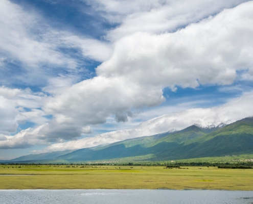 Kerkini, Greece, green hills and fields, cloudy sky