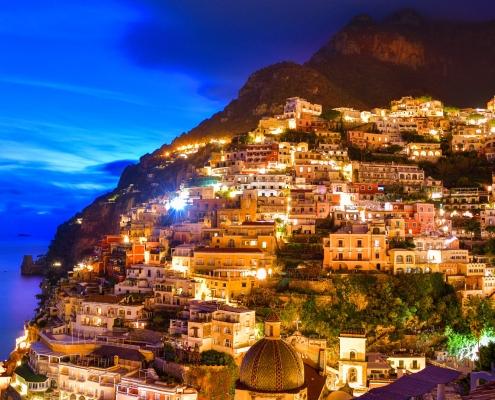 Positano, Italy, cityscape, city, evening, sky, sunset sunrise, hills, city on hills, mountain, sea, city by night, orange city, blue sky, sorrento