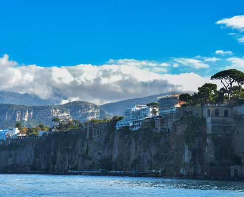 Sorrento, Italy, cityscape, city, sky, hills, city on hills, mountain, sea water, blue sky, clouds