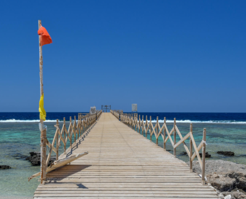 beach, sky, Africa, water, stone, beach, pier, blue sky, red flag, flag, czerwona flaga, molo, plaża
